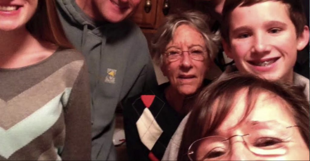 The Cottages of Perry Hall Video Thumbnail Family Group Surrounded by senior living resident